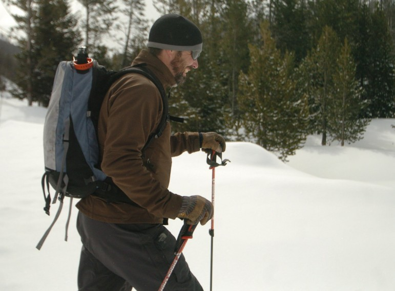 Doug Kraus, a firefighter who lives in Mammoth, skis into the Yellowstone National Park backcountry near Top Notch Peak.