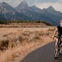 Ben Martin rides along a multipurpose pathway in Grand Teton National Park in October 2011. Martin opposes a proposed federal law that would require bikers to use pathways instead of adjacent roads. (Photo ©2011 Breeanne Martin)