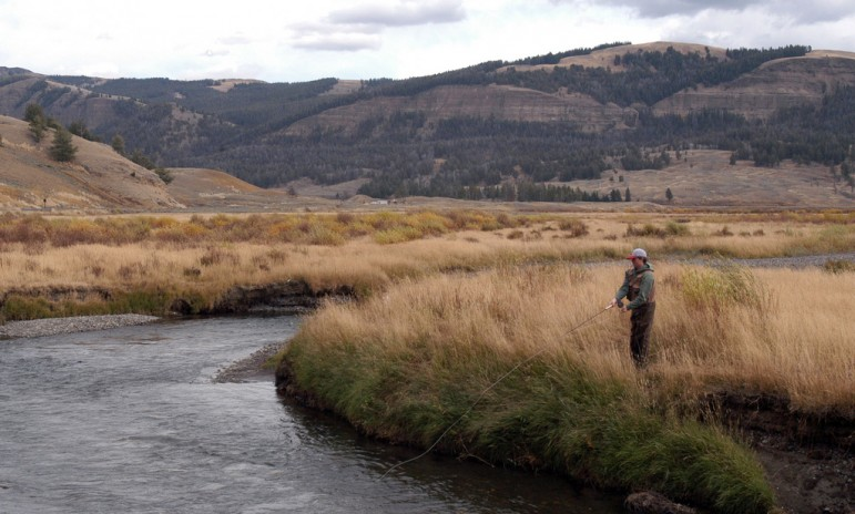 Dylan Riley fishes the Lamar River in Yellowstone National Park in October 2010 while visiting from California. (Ruffin Prevost/Yellowstone Gate)