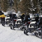 Four snowmobiles sit parked near Fishing Bridge in Yellowstone National Park. Planners say the average snowmobile party in the park has seven sleds. (Ruffin Prevost/Yellowstone Gate - click to enlarge)