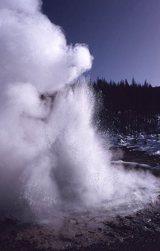Echinus Geyser erupting in February 1993 - NPS Photo by Jim Peaco