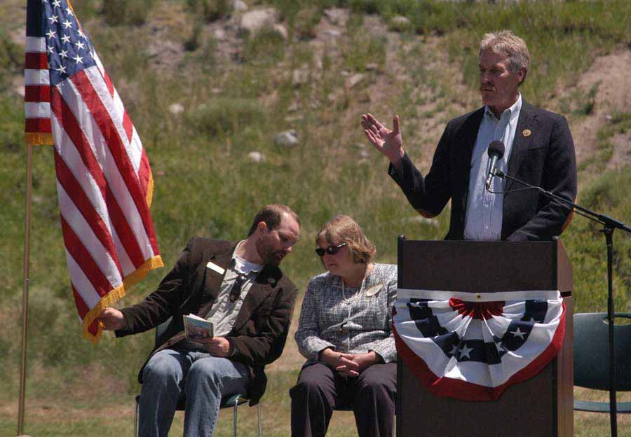 Bill Berg speaks during the Gardiner Gateway Project launch in Gardiner, Mont., sharing the stage with Daniel Bierschwale, President, Gardiner Chamber of Commerce and Clara Conner, Division Engineer, Western Federal Lands Highway Division. (Yellowstone Gate/Ruffin Prevost - click to enlarge)