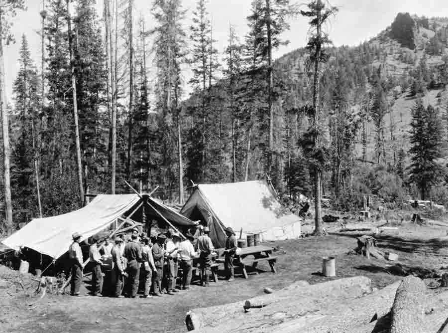 Firefighters move through a chow line during the 1937 Blackwater Fire east of Yellowstone National Park. Fifteen firefighters were killed in the blaze, and a series of events are scheduled for the 75th anniversary of the blaze. (Jack Richard photo courtesy of Buffalo Bill Historical Center McCracken Research Library PN.89.114.21398.4)