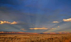 A Wyoming sunset along the Polecat Bench east of Yellowstone Park produces a visual phenomenon known as anti-crepuscular rays. (©Rob Koelling - click to enlarge)