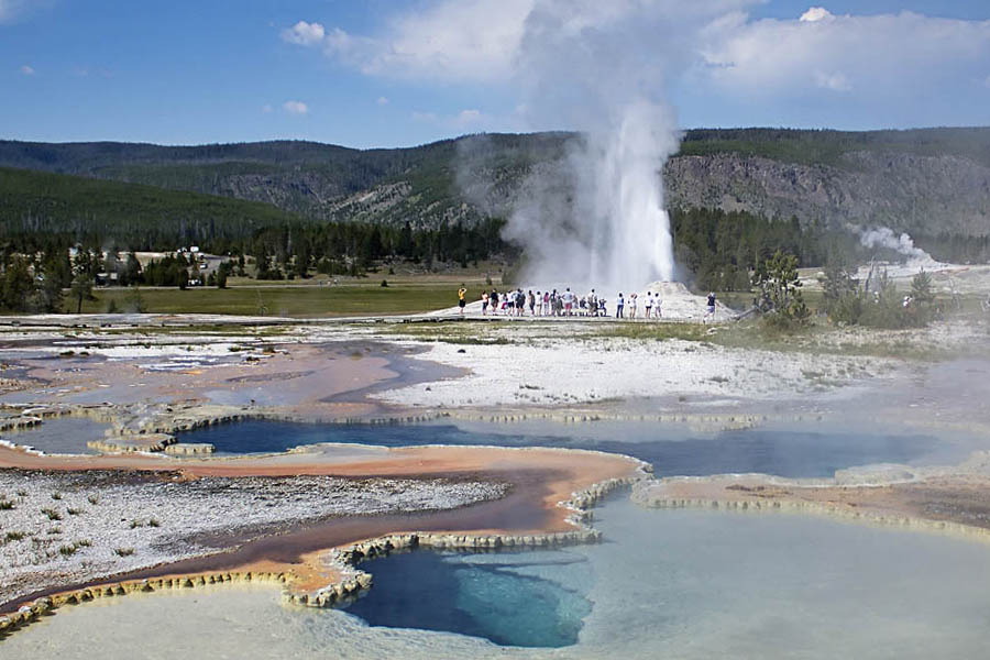 Visitors on Geyser Hill near Old Faithful in Yellowstone National Park watch an eruption of Lion Geyser. (Janet White/Geyser Watch - click to enlarge)