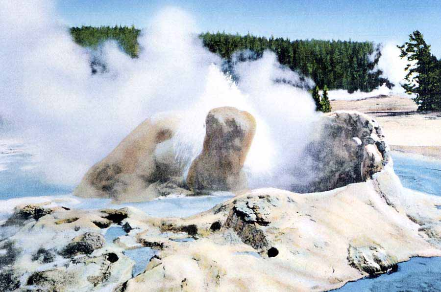 A postcard by historic Yellowstone National Park photographer Frank Haynes shows Grotto Geyser as it appeared in approximately 1913. (click to enlarge)