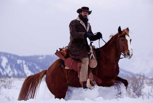 Actor Jamie Foxx rides a horse in front of what appears to be ski runs from the Snow King Resort in Jackson, Wyo., in the background. (©Columbia Pictures - click to enlarge)