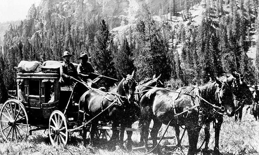 Horse-drawn coaches were the common method for travel in the early days of Yellowstone National Park. (Yellowstone Digital Slide File - click to enlarge)
