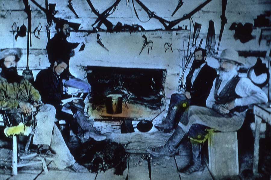 Yellowstone National Park's first commercial guide, Gilman Sawtell, far left, sits inside his cabin. (William Henry Jackson photo from the Yellowstone Digital Archive - click to enlarge)