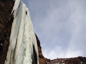 "Aaron Mulkey of Cody climbs along a frozen waterfall in the South Fork Valley, near Cody. Discovered by Mulkey and named ""The Testament,"" the climb covers a 180-foot pillar of ice supported only at the top where it leaves a cliff and the bottom where it reaches the ground. (File photo by Joel Anderson - click to enlarge)"