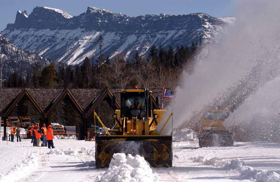 Workers look on as two rotary snowplows enter Yellowstone National Park on Monday to begin removing snow along the East Entrance Road. (Ruffin Prevost/Yellowstone Gate - click to enlarge)