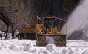 A rotary snowplow flying flags from the state of Wyoming and city of Cody removes snow from the East Entrance road of Yellowstone National Park on Monday. (Ruffin Prevost/Yellowstone Gate - click to enlarge)