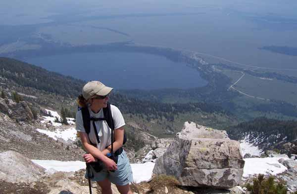 A hiker pauses along the Apex Trail in Grand Teton National Park. (NPS photo)