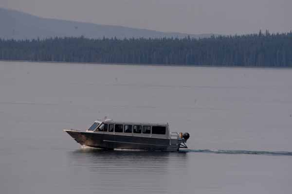 A commercial tour boat cruises Yellowstone Lake in Yellowstone National Park. (Yellowstone Gate/Ruffin Prevost)