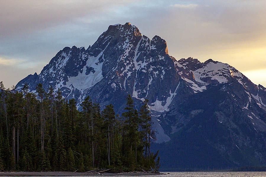 The last light of the longest day of the year kisses a bit of color onto Mt. Moran in Grand Teton National Park (© Janet White/GeyserWatch.com)