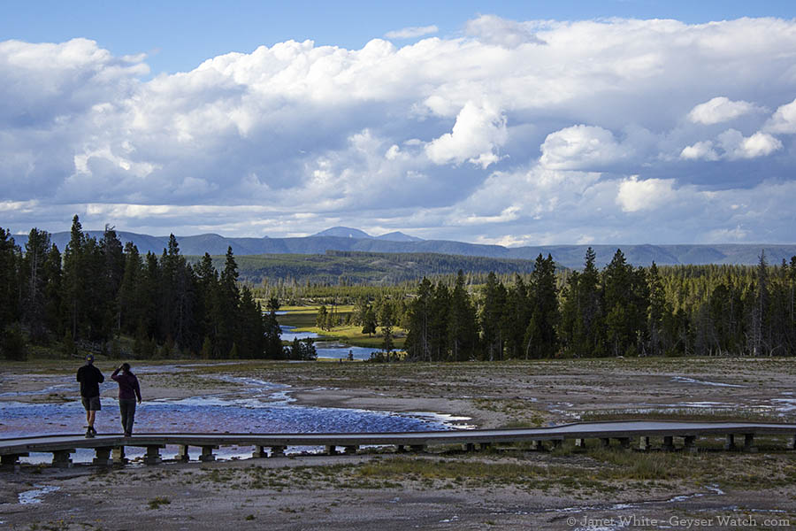 Visitors to Midway Geyser Basin pause and enjoy the view farther out in Yellowstone.