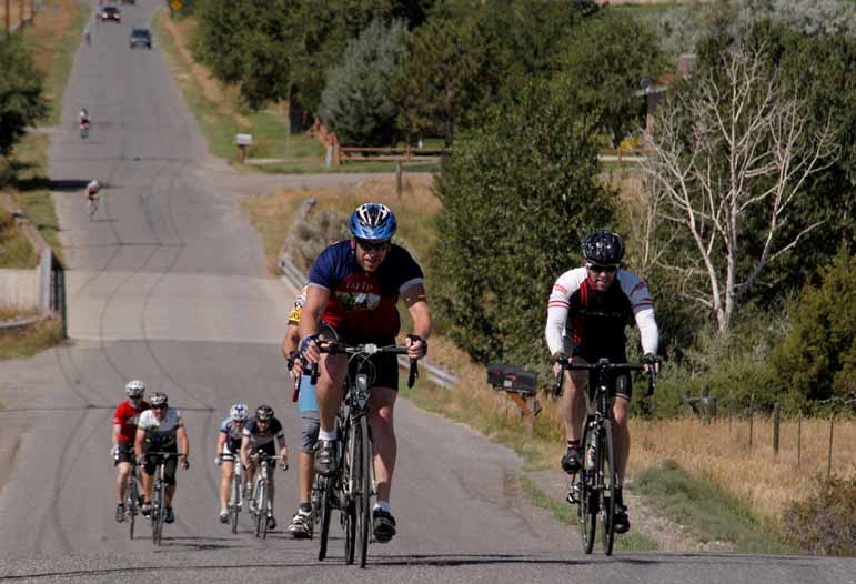 Bicyclists climb a hill along the Lower South Fork Road southwest of Cody, Wyo. during Cycle Greater Yellowstone last week.