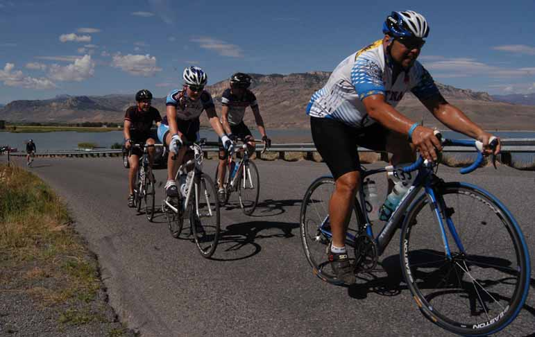Bicyclists participate in Cycle Greater Yellowstone near the Buffalo Bill Reservoir southwest of Cody, Wyo.