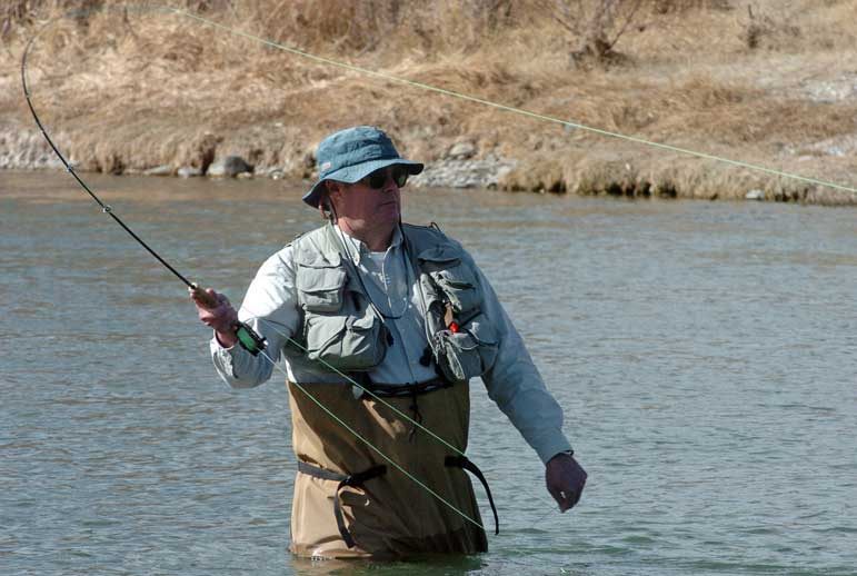 Fly-fisherman Jim Harris of Billings casts his line on the Shoshone River near the northern edge of Cody in this March 2009 file photo. Temperatures in the mid-60s lured many other fishermen to the water, which is fed by hot springs as it flows through town.