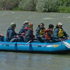 River Runners guide Larry Boyles, far left, launches a raft full of whitewater seekers into the middle of the Shoshone River, near the Belfry Highway bridge at the north edge of Cody, Wyo. in this June 2008 file photo.
