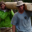 Participants in the Grand Teton National Park Youth Conservation Program move a log during a trail project.