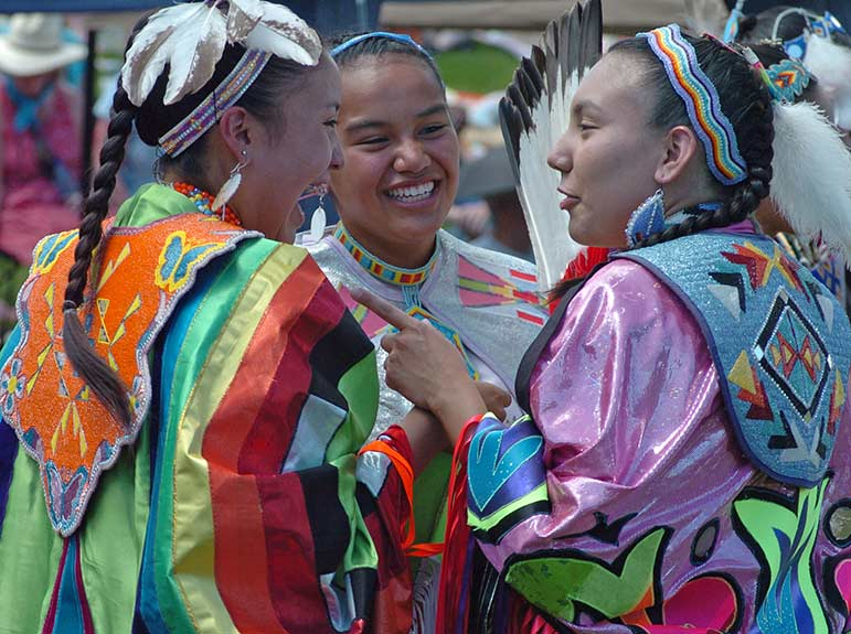 Cody, Wyo. is an authentic Western town that is home to several family-friendly attractions and events, including the Plains Indian Pow Wow at the Buffalo Bill Center for the West. Mikala SunRhodes, from left, Jasmine Walks Over Ice and Tia Hoops chat between dances at the 2008 Plains Indian Pow Wow.
