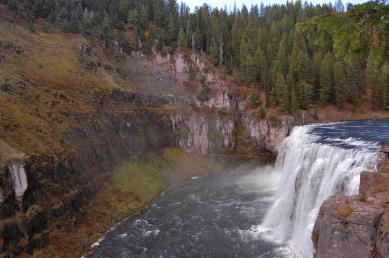 Mist from Upper Mesa Falls in the Caribou-Targhee National Forest in Idaho keeps the surrounding area green despite fall colors emerging across the region.