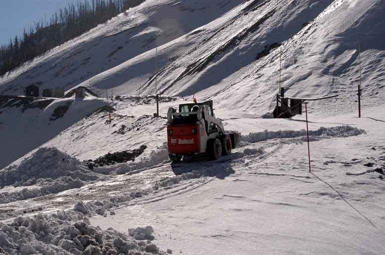 A National Park Service maintenance worker clears a path through early snow last month to allow for deployment of a howitzer used for avalanche mitigation in Yellowstone National Park. (Ruffin Prevost/Yellowstone Gate)