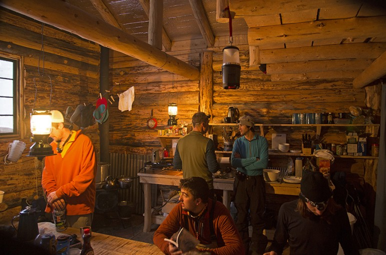 The interior of the Woody Creek Cabin near Cooke City, Mont. is heated by wood stove. Snow is melted for and meals are cooked on a propane stove.