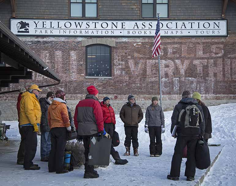 Students discuss what they have learned after a wilderness first aid training session outside the Yellowstone Association building in Gardiner, Montana.