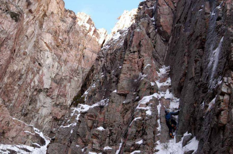 A climber looks for the best route up a rock face in Shoshone Canyon on Saturday during the 16th Annual Cody Ice Climbing Festival in Cody, Wyo.