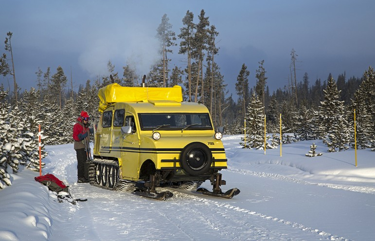 A snow coach drops off skiers near Kepler Cascades in Yellowstone National Park.