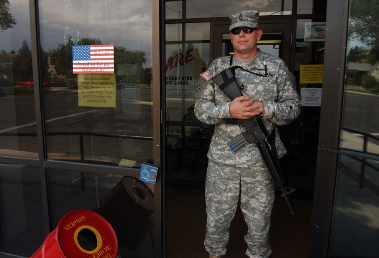 A member of the Wyoming National Guard, who asked not to be identified, stands guard  at the entrance to the old Law Enforcement Center at Beck Avenue and 11th Street during the 2006 Hells Angels World Run in Cody, Wyo.