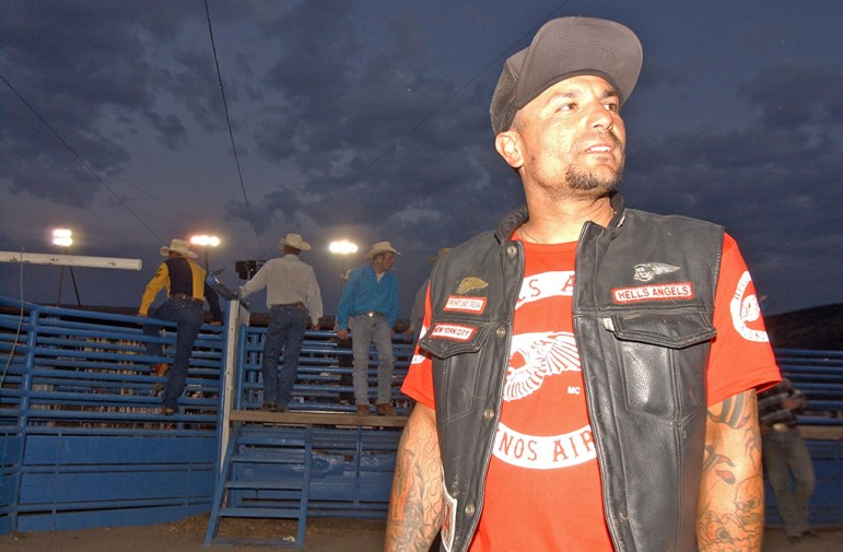 Hells Angels member Jose G. participated in a special bull-riding contest for the bikers at the Cody Nite Rodeo during the group's 2006 World Run in Cody, Wyo.