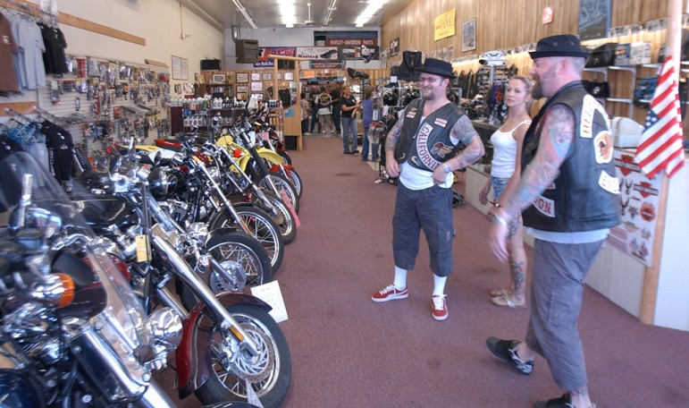 Members of the Hells Angels Motorcycle Club and a friend check out the bikes at Cody Custom Cycle during the group's 2006 World Run in Cody, Wyo.