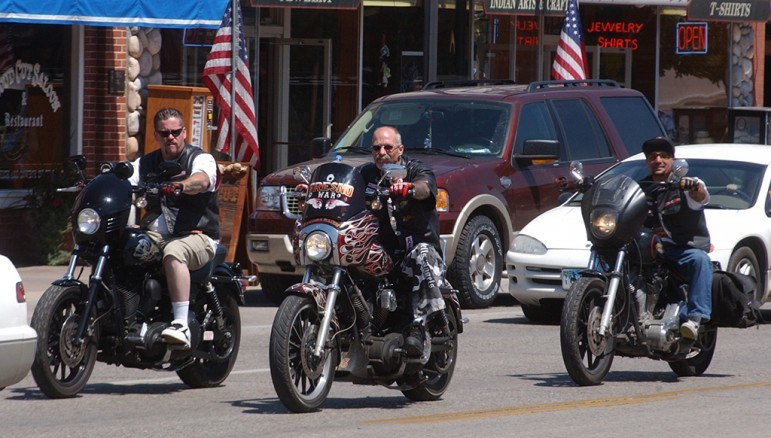 Hells Angels motorcycle club members cruise Sheridan Avenue in Cody, Wyo. during the group's 2006 World Run.