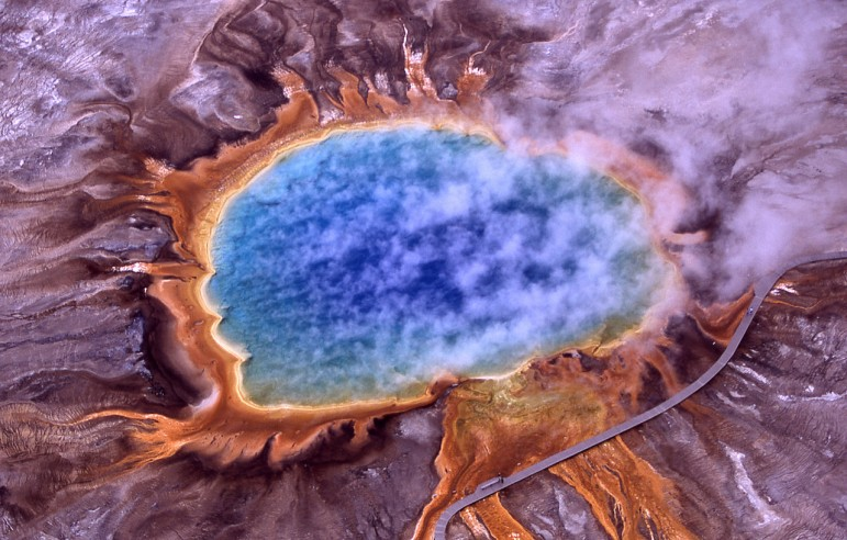 Grand Prismatic Spring is the largest hot spring in Yellowstone National Park. Its colors are the result of different forms of microbial life thriving in different temperature zones.