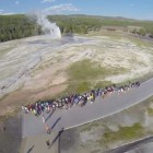 A still image from a video posted to YouTube shows Old Faithful erupting as seen from a camera drone in 2013, before Yellowstone National Park and the National Park Service banned unmanned aerial vehicles.