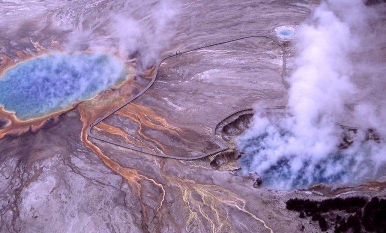 Steam rises from Excelsior Geyser Crater and Grand Prismatic Spring in Yellowstone National Park.