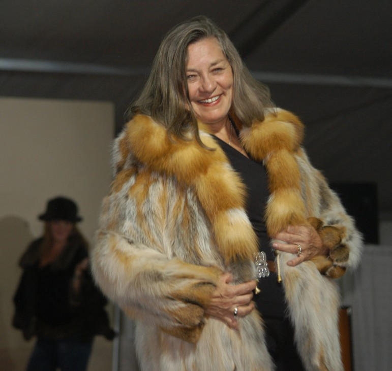 Mayor Nancy Tia Brown models a fur made by Joel Kaye during the Cody High Style Fashion show on Wednesday in Cody, Wyo.