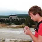Self-described 'geyser gazer' Ryan Maurer takes notes after the eruptions of Lion Geyser in Yellowstone National Park.