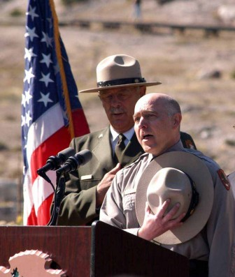 "Michael Breis sings ""The Star-Spangled Banner"" as Yellowstone National Park Superintendent Dan Wenk looks on during a Sept. 3 naturalization ceremony at Mammoth Hot Springs."