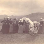 Some women stand around a tent in the Paradise Valley during a 1900 trip to Yellowstone National Park.