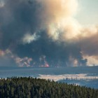 The Spruce fire burning in Yellowstone National Park, as seen from Dunraven Pass, covers a little over 2,100 acres.