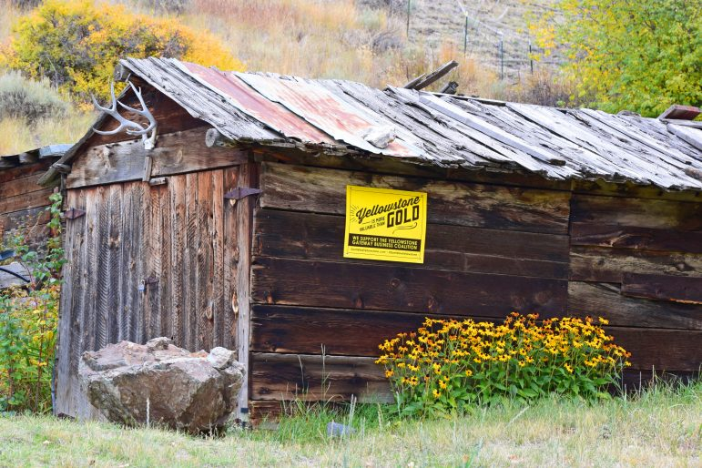 A cabin in Old Chico, Mont., the site of a historic mining community, displays a sign in opposition to new mining proposed for the Paradise Valley.