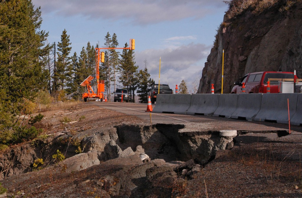 Traffic in October moves along a single lane of the road between Syvlan Pass and Fishing Bridge in Yellowstone National Park. A portion of the road washed away in May, and repairs are not expected to begin until summer 2012 at the earliest.