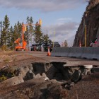 Traffic in 2012 moves along a single lane of the then-damaged road between Sylvan Pass and Fishing Bridge in Yellowstone National Park.