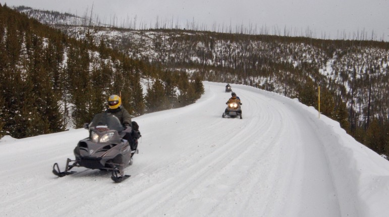 Commercial snowmobile guide John Davis leads visitors through Yellowstone National Park during a 2007 day trip.