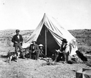 Frank Bradley, in tent, relaxes with his colleagues in Yellowstone National Park during an 1872 geological expedition. Bradley reported hearing strange sounds along the shore of Yellowstone Lake. (USGS photo - click to enlarge)