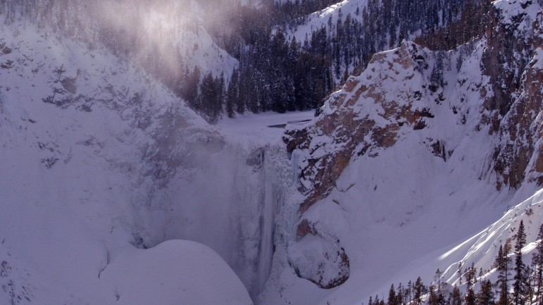 Ice forms along sections of the Lower Falls in the Grand Canyon of the Yellowstone River as seen in this 2012 file photo.